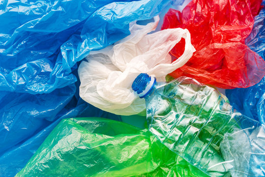 Pile of colorful plastic bags and bottle