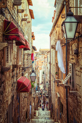 Tuinposter Smal steegje Famous narrow alley of Dubrovnik old town, Croatia