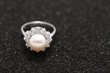 Pearl on diamond ring
