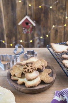 Various home-baked gingerbread cookies on wooden plate