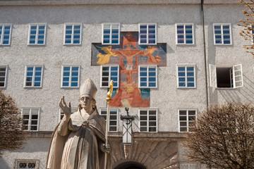 """Statue of St. Rupert, patron saint of Salzburg, fresco """"Gnadenstuhl der Dreifaltigkeit"""" (Mercy seat of Trinity) by Anton Faistauer (1926) , St.Benedict college, St. Peter's Abbey, Salzburg, Austria"""