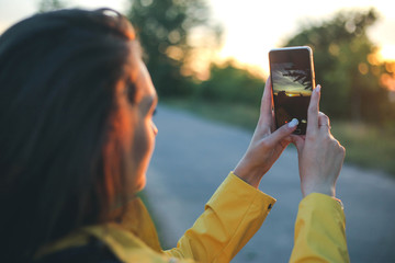 Hipster Traveler Girl Taking Photos Of Landscape With Mobile Smart Phone