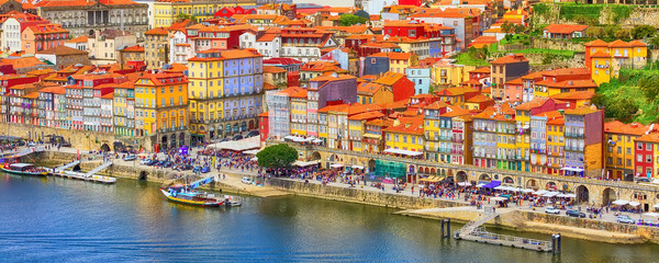 Porto, Portugal old town ribeira aerial banner view with colorful houses, Douro river and boats