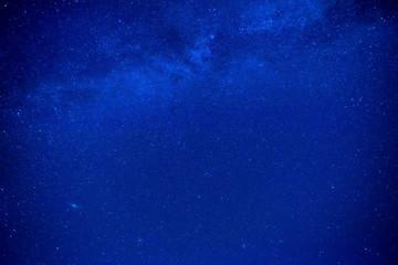 Dark blue night sky with many stars, galaxy background
