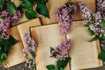 Wall Murals Lilac Cup of tea, lilac flowers, book on dark wooden background