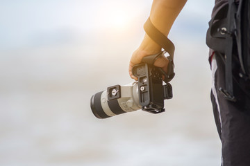 photographer is holding a camera