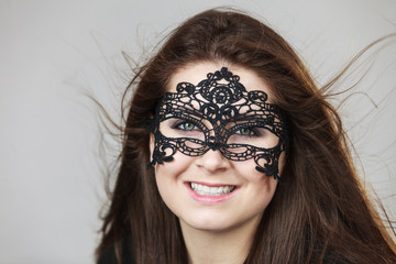 Mysterious woman wearing lace mask