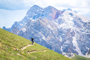 Woman mountain biking, Fanes-Sennes-Braies National Park, Dolomites, Trentino, South Tyrol, Italy