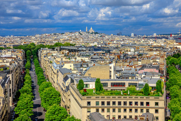Paris skyline aerial view panorama from top of Arc de Triomphe. Distant Sacre-Coeur church of Paris or Sacred Heart Basilica Landmark in Paris, France, Europe.