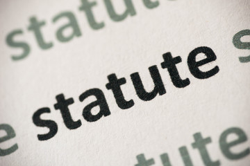 word statute printed on paper macro