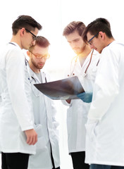 group of radiologists discussing x-ray