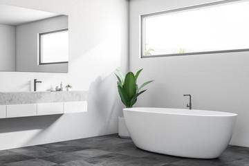 White minimalistic bathroom corner, window