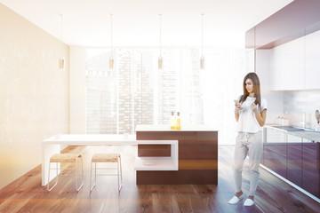 Brown and white loft kitchen interior, woman