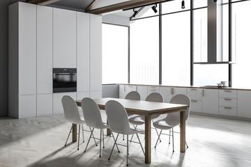 White panoramic kitchen and dining room corner