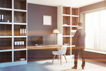Panoramic black home office corner, poster, man