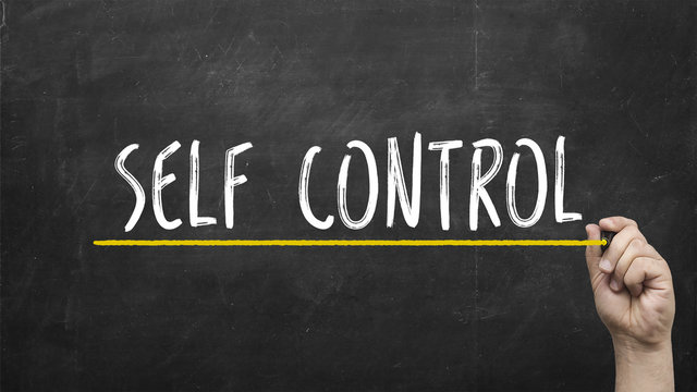 Self control concept. Hand with yellow marker writing self control inscription text on chalkboard.