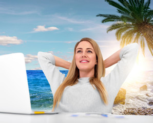 Woman dreaming about vacation at work.