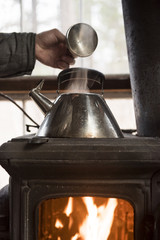 Kettle boiling on woodstove