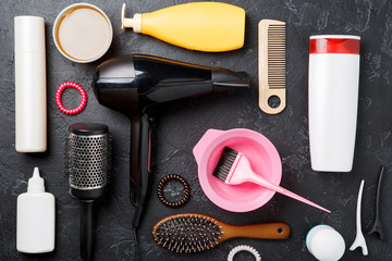 Image of hairdresser accessories on black background