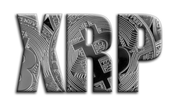 XRP. The inscription has a texture of the photography, which depicts several silver bitcoins