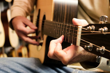Male hands playing a guitar