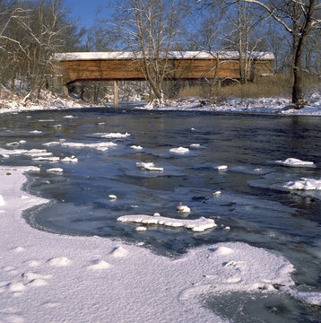 Covered bridge over icy Shenandoah River in winter;  Virginia