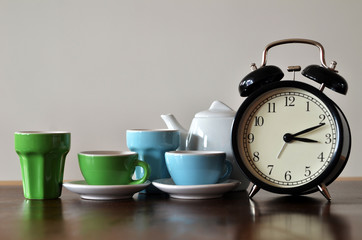 Alarm clock with colorful tea set