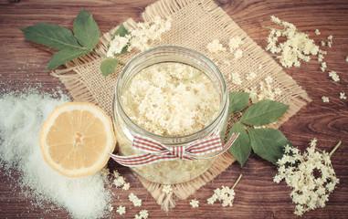 Vintage photo, Elderberry flowers and ingredients for preparing fresh healthy juice, alternative medicine concept