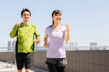 young asian couple running
