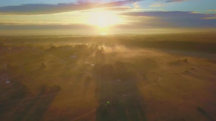 Wall Mural - Beautiful aerial shot of thick layer of fog on fields during sunrise with expanse and endless skyline
