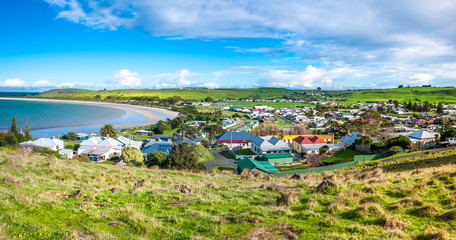 Beautiful panorama view of Stanley's residential houses in town and coast line against blue sky on a bright sunny day. Elevated view from 'The Nut' - a volcanic plug in Stanley, Tasmania, Australia Fotomurales