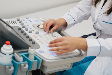 Ultrasound medical device for diagnostics. The procedure of ultrasound examination. Diagnosis and research of diseases with help of ultrasound of abdomen and give to pregnant women of the hospital.