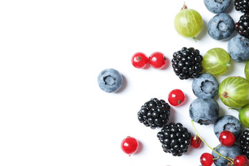 Mix of different fresh berries on white background