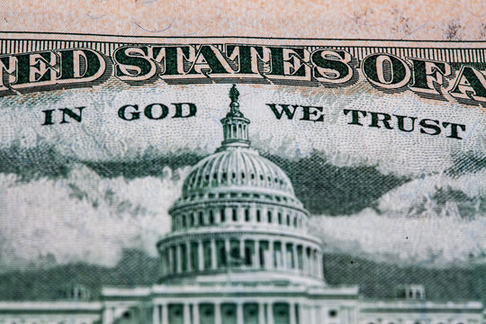 Extreme closeup of United States Capitol depicted on 50 USD bill reverse with the words In God We Trust. Shallow depth of field