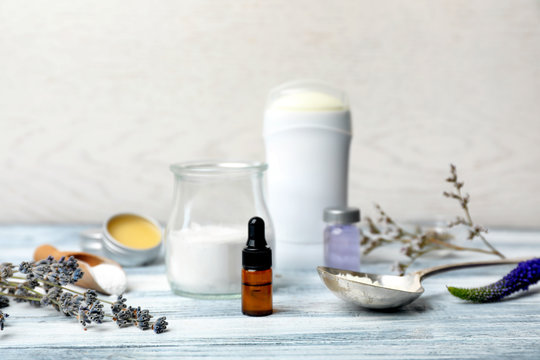 Natural ingredients for deodorant on wooden table