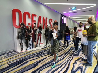 People go to watch a movie at Novo Cinemas at Seef Mall, in Muharraq
