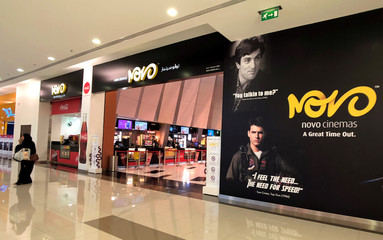 A visitor leaves Novo Cinemas at Seef Mall, in Muharraq