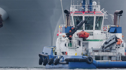 TUG AND GAS CARRIER - A great tanker towed by a tugboat