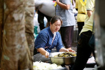 Family members cook for rescue workers near Tham Luang cave complex in the northern province of Chiang Rai