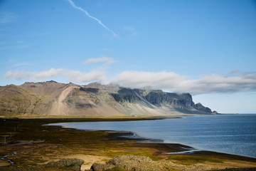 Landscapes in Iceland. Atlantic coast. Mountain on the horizon.