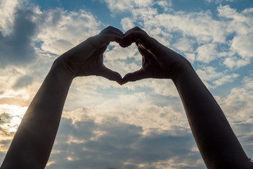hands forming a heart - spread the love