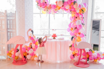 Candybar for child's birthday decorated withpink balloons and flamingos
