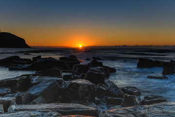 Sunrise and the Rocky Sea