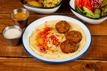 Tasty hummus with falafel