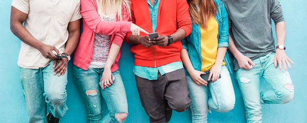 Group of friends watching smart mobile phone