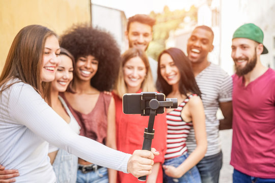 Happy millennials friends making video feed with smartphone outdoor