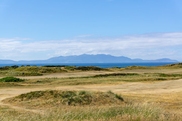 Ayrshire Golf Course to Arran hills in the hazey distance.