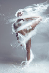 Printed roller blinds People Dancing in flour. Redhead muscle performer woman dancer in dust / fog. Girl wearing white top and shorts making dance element in flour cloud on isolated background. Surreal concept.