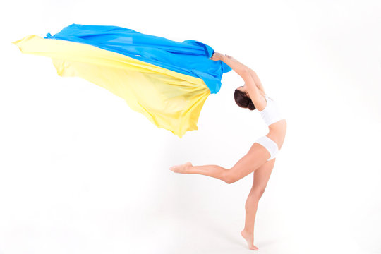 Pure clean beauty ukrainian girl / woman / female wearing white underwear dancing with blue and yellow silk fabric as symbol of Ukraine flag on white isolated background