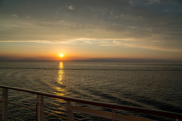 stunning sunset over the ocean seen from a cruiseship